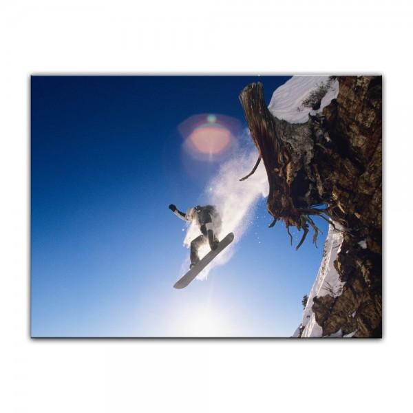 Leinwandbild - Snowboarder im Sprung