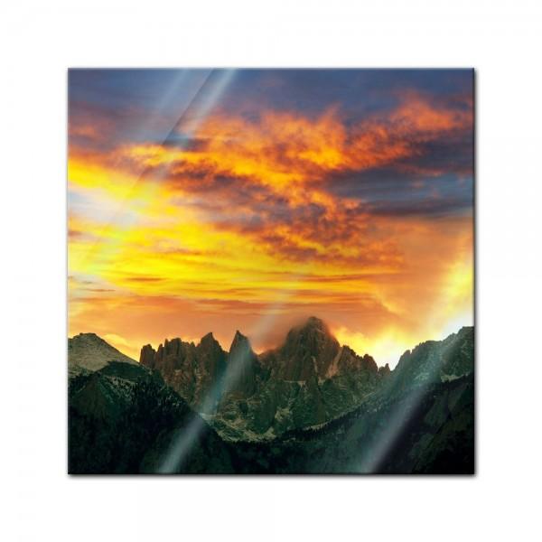 Glasbild - Berglandschaft im Sonnenuntergang