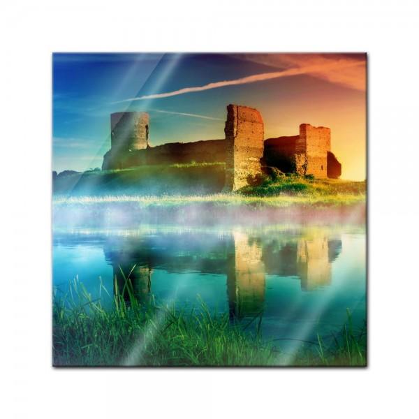 Glasbild - Alte Burgruine im Sonnenuntergang