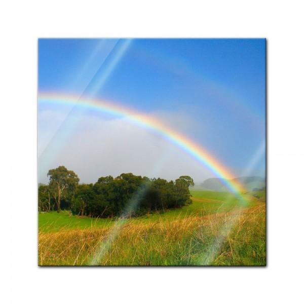 Glasbild - Regenbogen über Wiese