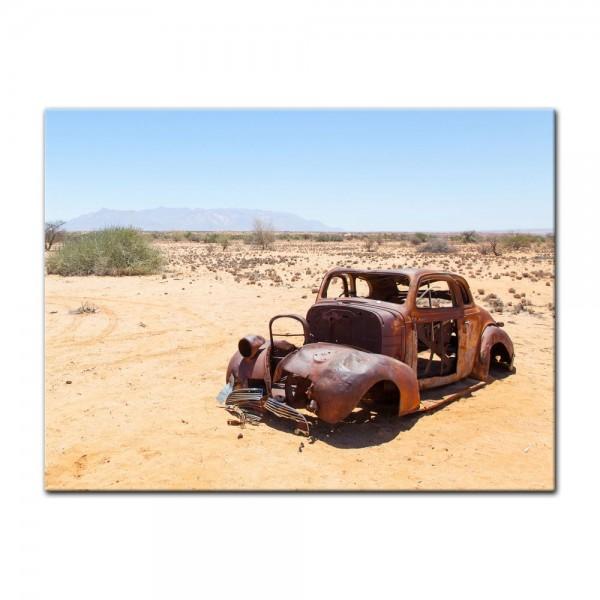 Leinwandbild - Verlassenes Auto in der Wüste von Namibia
