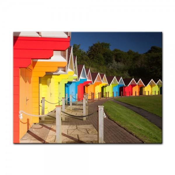 Leinwandbild - Bunte Strandhütten in Großbritannien