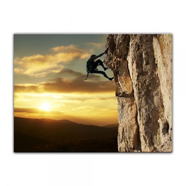 Leinwandbild - Bergsteiger im Sonnenuntergang