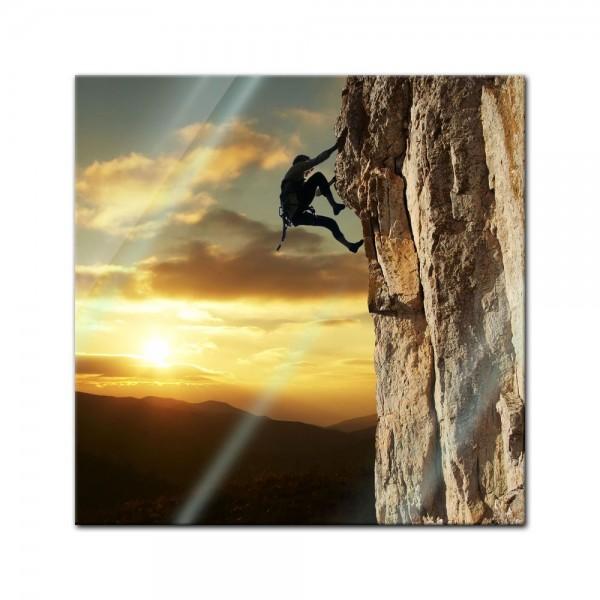 Glasbild - Bergsteiger im Sonnenuntergang