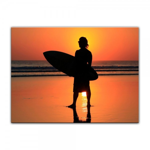 Leinwandbild - Surfer im Sonnenuntergang