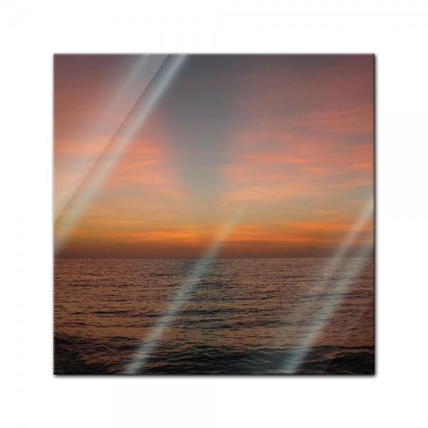 Glasbild - Sonnenuntergang am Meer